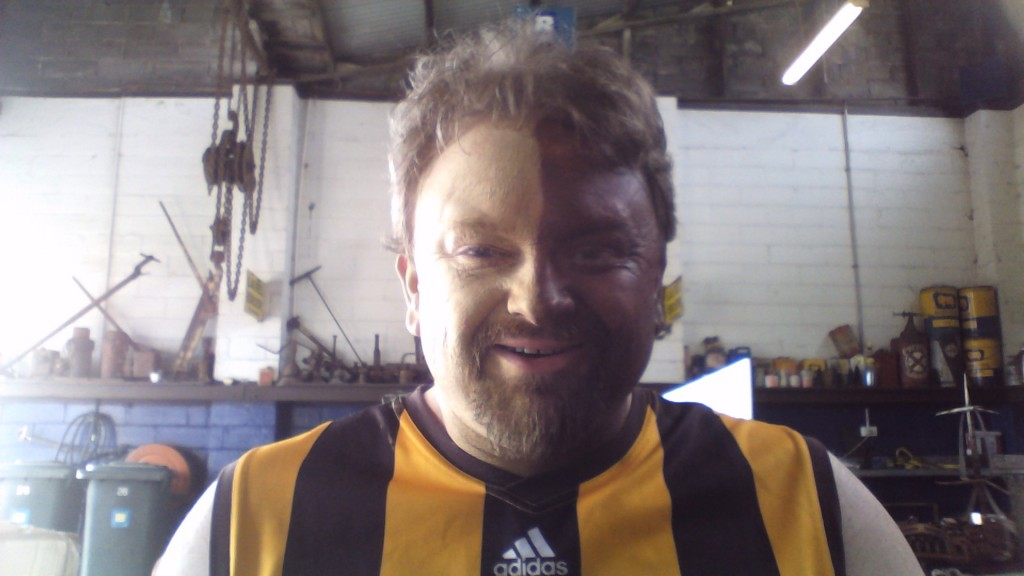 Mark face painted for the Hawthorn Footbal Club
